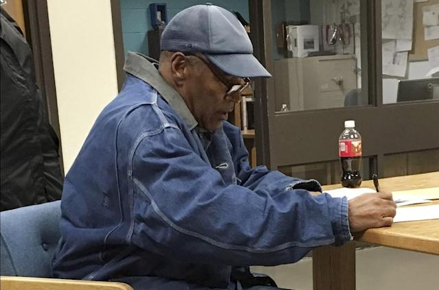 This image released by the Nevada Department of Corrections shows O.J. Simpson signing documents and leaving Lovelock Correctional Centre in Lovelock, Nevada, early on October 1, 2017 (AFP Photo/)
