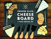 <p>This <span>Slate Cheese Board 7-Piece Serving Tray Set </span> ($16) is great for entertaining.</p>