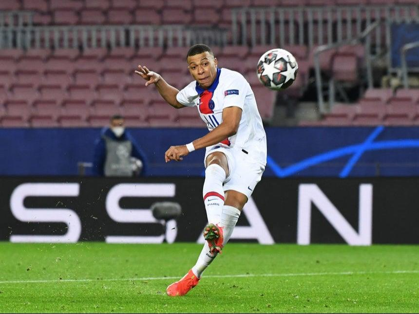 <p>Kylian Mbappe of Paris Saint-Germain completes his hat-trick against Barcelona</p> (Getty)