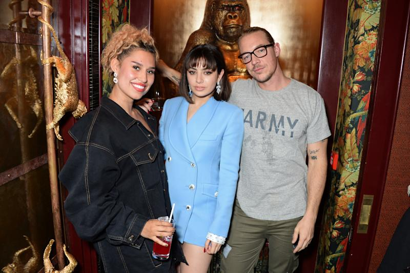 LONDON, ENGLAND - JUNE 10: (L to R) Raye, Charli XCX and Diplo attend the GQ Style and Browns LFWM Party at Annabels on June 10, 2018 in London, England. (Photo by David M. Benett/Dave Benett/Getty Images for Annabel's)