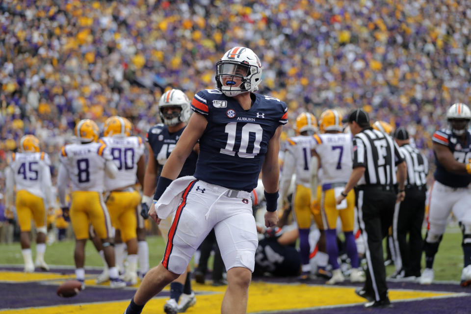 Auburn quarterback Bo Nix (10) celebrates his touchdown carry in the first half of an NCAA college football game against the LSU in Baton Rouge, La., Saturday, Oct. 26, 2019. (AP Photo/Gerald Herbert)