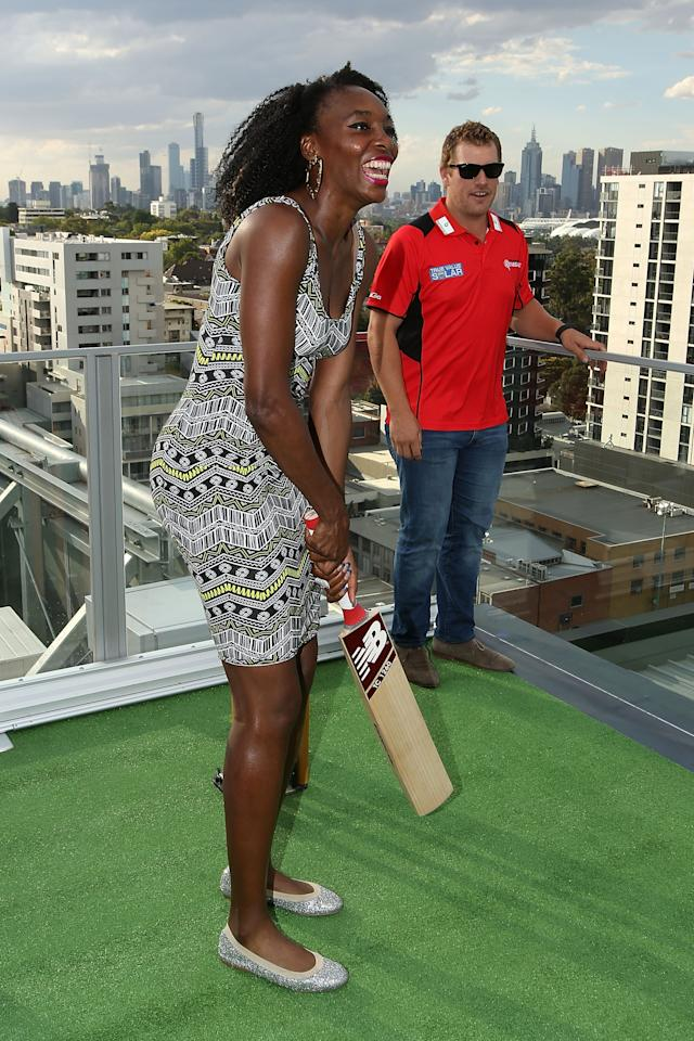MELBOURNE, AUSTRALIA - JANUARY 09: Serena Williams of the USA is coached in cricket batting by Aaron Finch of the Melbourne Renegades during a meet & greet with the Melbourne Renegades at The Olsen on January 9, 2014 in Melbourne, Australia. (Photo by Graham Denholm/Getty Images)