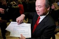 Softbank CEO Masayoshi Son speaks to the press after meeting with U.S. President-elect Donald Trump at Trump Tower in Manhattan, New York City, U.S., December 6, 2016. REUTERS/Brendan McDermid
