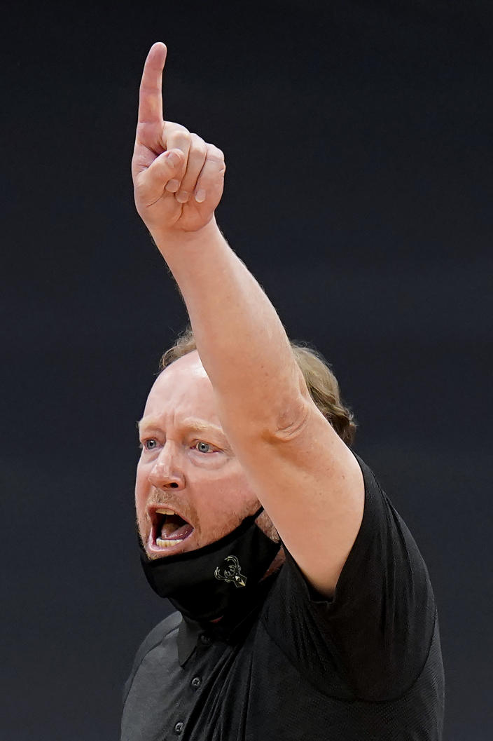 Milwaukee Bucks head coach Mike Budenholzer calls in a play during the second half of an NBA basketball game against the Toronto Raptors Wednesday, Jan. 27, 2021, in Tampa, Fla. (AP Photo/Chris O'Meara)