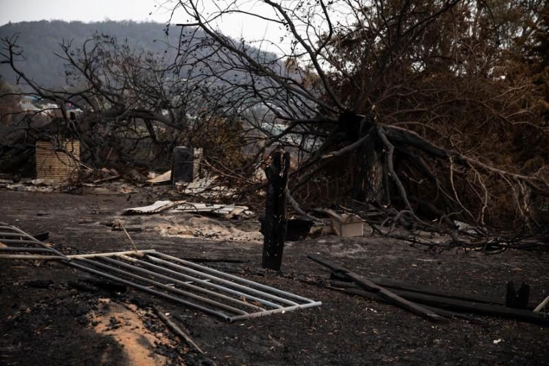 The remains of a structure are seen following a bushfire in the village of Cobargo