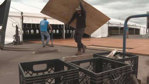The tent for this year's P.E.I. International Shellfish Festival came down Tuesday after the event was cancelled due to rising COVID-19 case counts. (Brian Higgins/CBC - image credit)