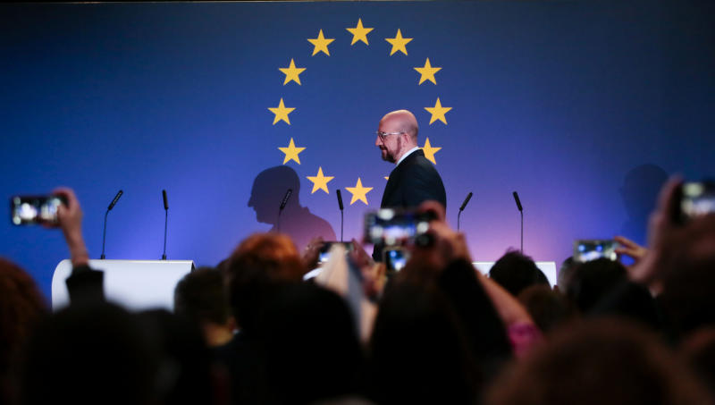European Council President Charles Michel arrives for a media conference at the Parlamentarium in Brussels, Friday, Jan. 31, 2020. The U.K. is due to leave the EU on Friday the first nation in the bloc to do so. (AP Photo/Virginia Mayo)