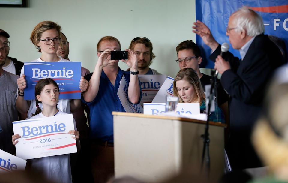 Supporters listen to Democratic presidential candidate Sen. Bernie Sanders speak during a rally with local residents on Saturday, May 30, 2015, in Ames, Iowa.