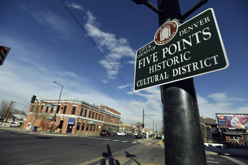 Street sign for the Five Points area of Denver with buildings in the background