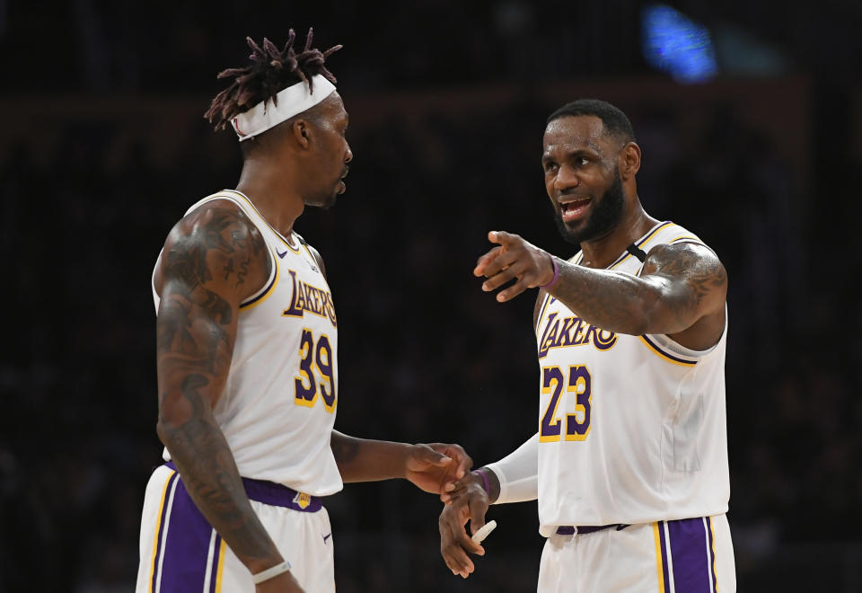 LOS ANGELES, CA - JANUARY 05: Dwight Howard #39 and LeBron James #23 of the Los Angeles Lakers during game agaisnt the Detroit Pistons at Staples Center on January 5, 2020 in Los Angeles, California. Lakers won 106-99. NOTE TO USER: User expressly acknowledges and agrees that, by downloading and/or using this photograph, user is consenting to the terms and conditions of the Getty Images License Agreement. (Photo by John McCoy/Getty Images)