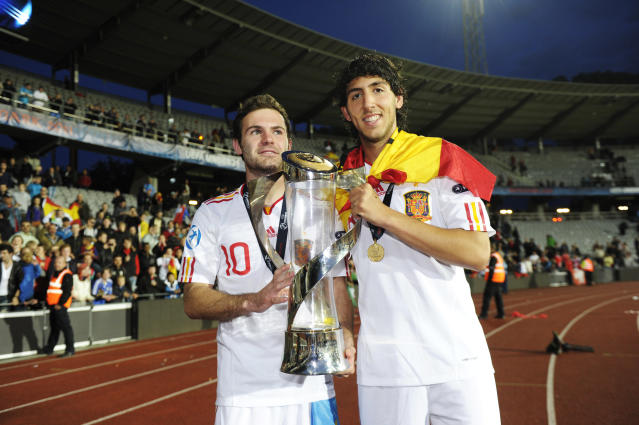 Spain's Daniel Parejo (R) and Juan Mata celebrate with the trophy at the end of the UEFA Under-21 European Championship final football match Spain vs Switzerland at the Aarhus Stadium, on June 25, 2011. Spain win the final with 2-0.AFP PHOTO/JONATHAN NACKSTRAND (Photo credit should read JONATHAN NACKSTRAND/AFP/Getty Images)
