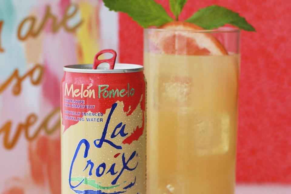 """<p>Mix pear juice and a little bit of lemon juice with LaCroix's Melón Pomelo sparkling water for a mocktail that tastes like cantaloupe, grapefruit and pears.</p> <p><a href=""""https://www.thedailymeal.com/recipes/grapefruit-pear-sparkler-mocktail-lacroix?referrer=yahoo&category=beauty_food&include_utm=1&utm_medium=referral&utm_source=yahoo&utm_campaign=feed"""" rel=""""nofollow noopener"""" target=""""_blank"""" data-ylk=""""slk:For the Grapefruit Pear Sparkler recipe, click here."""" class=""""link rapid-noclick-resp"""">For the Grapefruit Pear Sparkler recipe, click here.</a></p>"""