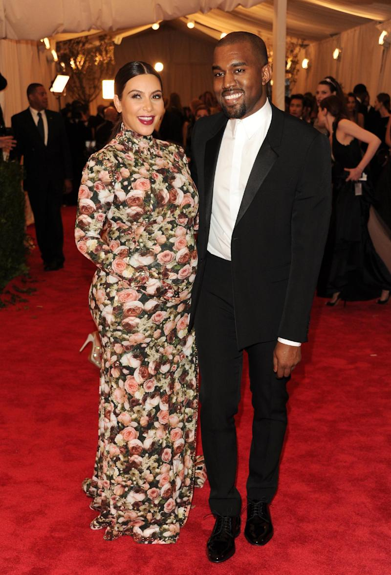 """FILE - In this May 6, 2013 file photo, Kim Kardashian and Kanye West attend The Metropolitan Museum of Art's Costume Institute benefit celebrating """"PUNK: Chaos to Couture"""" in New York. Kardashian ranks number three on Google's list of most-searched people in the U.S., the only non-singer on the list. (Photo by Evan Agostini/Invision/AP, file)"""