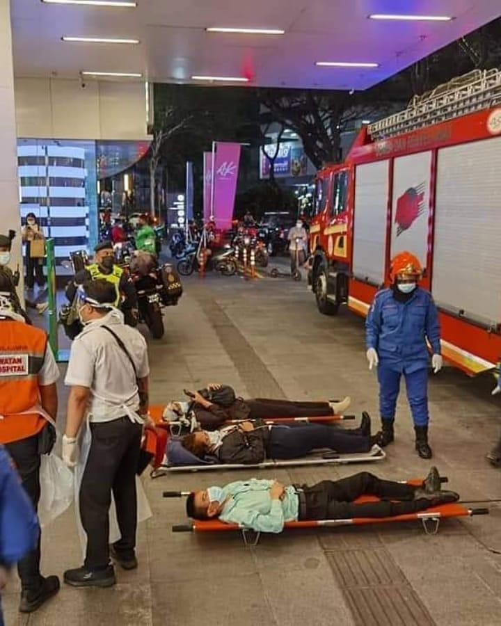 People lying on stretchers outside the KLCC train station. Photo: KL Fire and Rescue Department
