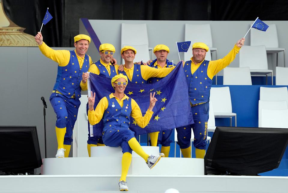 Team Europe fans pose for photos following the opening ceremony