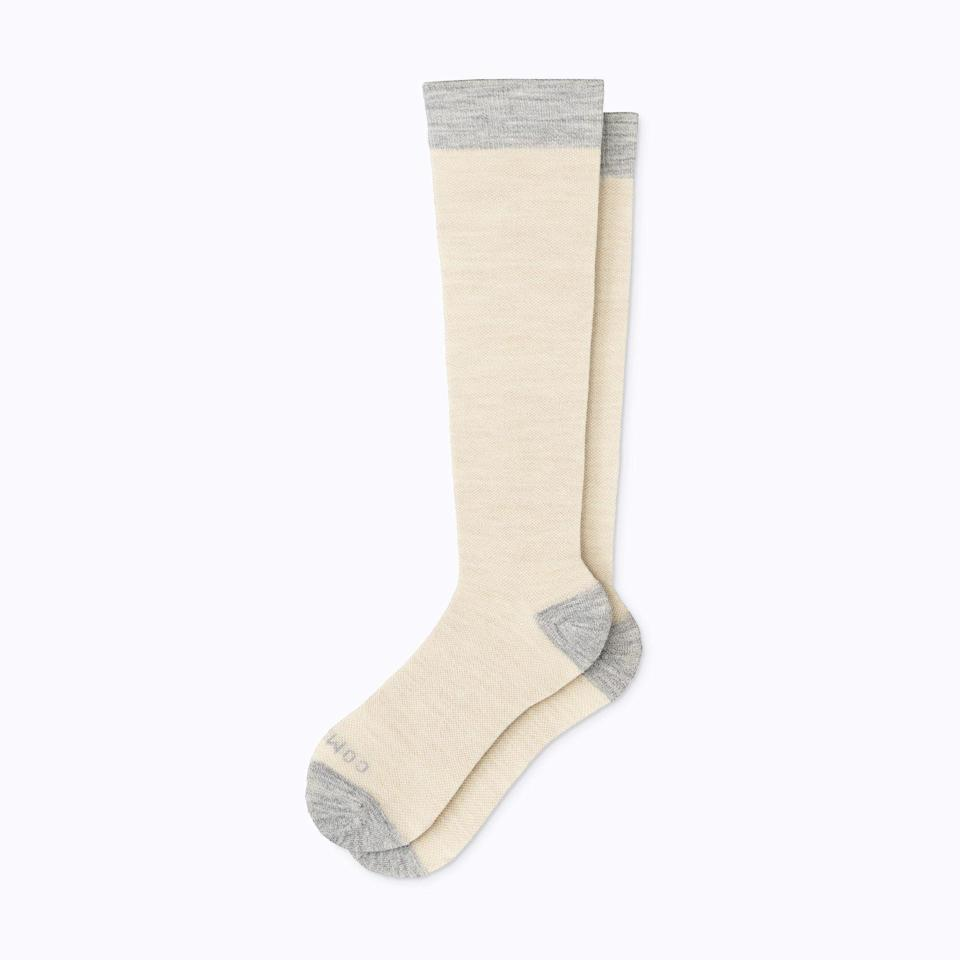 """Comrad's energizing compression socks are ideal for days when she finds herself sitting or walking for longer than usual. $38, Comrad. <a href=""""https://www.comradsocks.com/collections/merino-wool-compression-socks/products/merino-wool-socks-colorblock?variant=31509578907682"""" rel=""""nofollow noopener"""" target=""""_blank"""" data-ylk=""""slk:Get it now!"""" class=""""link rapid-noclick-resp"""">Get it now!</a>"""