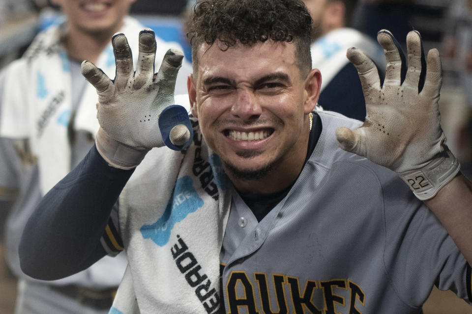 Milwaukee Brewers' Willy Adames poses for a photo after hitting a two-run home run against the Atlanta Braves during the fourth inning of a baseball game Friday, July 30, 2021, in Atlanta. (AP Photo/Hakim Wright Sr.)
