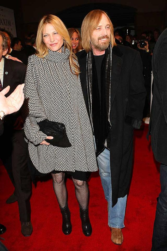 "Music legend Tom Petty and his wife of six years, Dana York, rock the red carpet upon entering the Maxim party. Tom keeps it casual in an overcoat and jeans, while Dana opts for a fabulously formal poncho and fishnet stockings. Jason Merritt/<a href=""http://www.wireimage.com"" target=""new"">WireImage.com</a> - February 1, 2008"