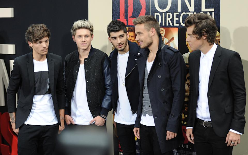 British boy band One Direction, from left, Louis Tomlinson, Niall Horan, Zayn Malik, Liam Payne and Harry Styles attend the premiere of