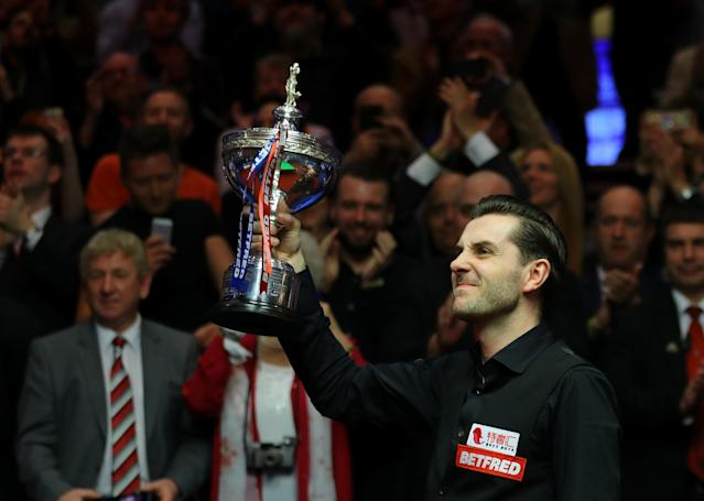 Mark Selby poses with the trophy after beating John Higgins: Getty