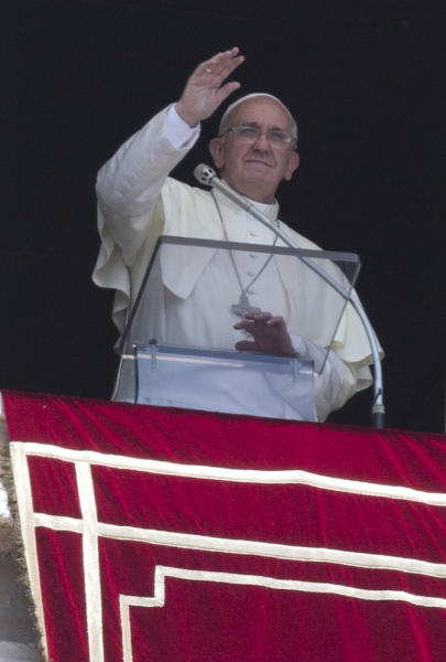 Pope Francis blesses the faithful during the Angelus noon prayer he celebrated from the window of his studio overlooking St. Peter's Square, at the Vatican, Sunday, July 21, 2013. Francis leaves Monday, July 22, for Rio de Janeiro, where a million or more young Catholics are expected to celebrate the World Youth Day with their new pope. The trip is the first international journey for the 76-year-old Argentine since he became pope in March. (AP Photo/Andrew Medichini)
