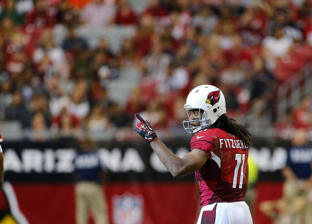 Arizona Cardinals wide receiver Larry Fitzgerald acknowledges his teammates after making his 800th career catch during the second half of an NFL football game against the Atlanta Falcons, Sunday, Oct. 27, 2013, in Glendale, Ariz. (AP Photo/Matt York)