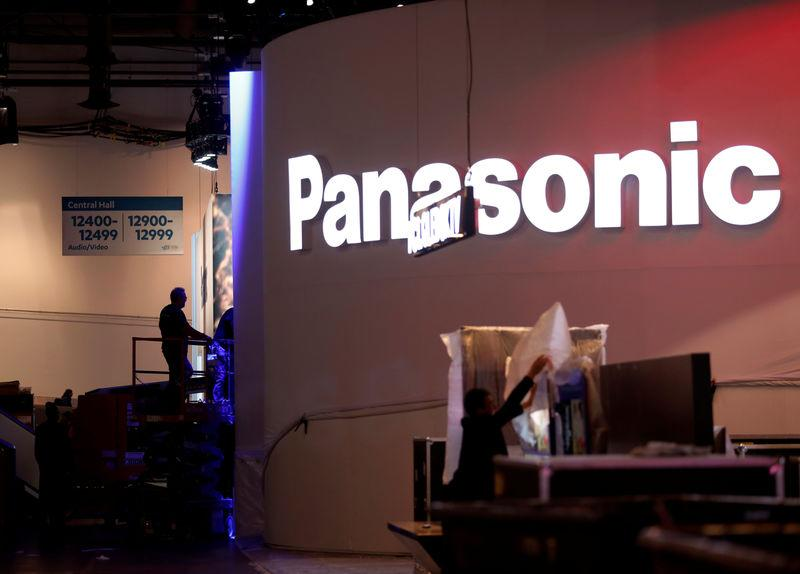 FILE PHOTO: Workers set up a Panasonic booth at the Las Vegas Convention Center in preparation for 2019 CES in Las Vegas