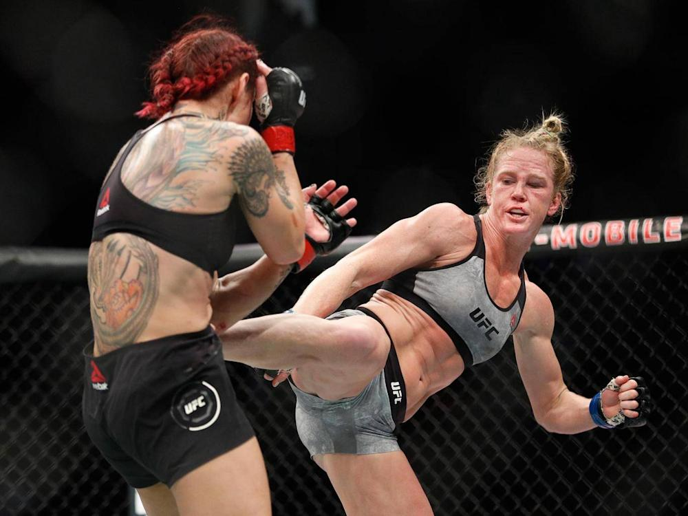 Holm attempted to gain success with a series of kicks to the head and body of Cyborg (AP)