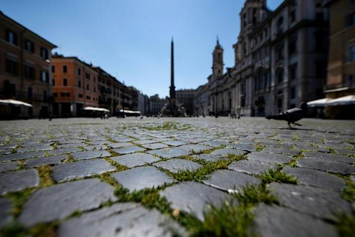 Deserted streets can also provide the chance to notice new things, like the grass growing between the cobblestones of Rome's Piazza Navona (AFP Photo/Tiziana FABI)