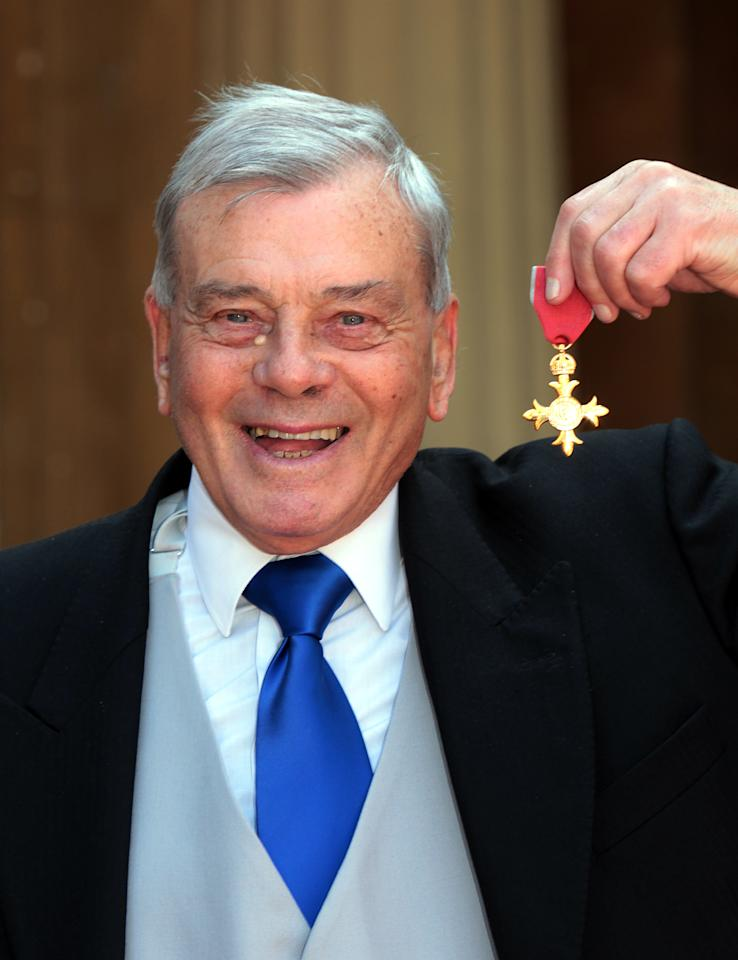 Former British cricket umpire Harold (Dickie) Bird poses for pictures after receiving the Officer of the British Empire, (OBE) which was presented to him by Prince Charles at Buckingham Palace in London, on May 15, 2012. AFP PHOTO/Sean Dempsey/POOLSEAN DEMPSEY/AFP/GettyImages