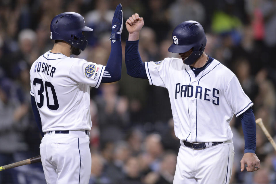 San Diego Padres' Wil Myers is congratulated by Eric Hosmer after hitting a home run during the seventh inning of a baseball game against the Arizona Diamondbacks Tuesday, April 2, 2019, in San Diego. (AP Photo/Orlando Ramirez)