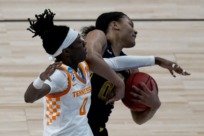 Tennessee guard Rennia Davis (0) and Michigan forward Naz Hillmon (00) battle for a rebound during the first half of a college basketball game in the second round of the women's NCAA tournament at the Alamodome in San Antonio, Tuesday, March 23, 2021. (AP Photo/Charlie Riedel)