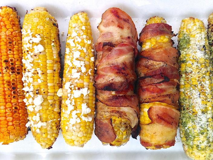 "<p>We've got six magical ways to top grilled corn-and bacon-wrapped isn't even the best one.</p><p>Get the recipe from <a href=""https://www.delish.com/cooking/g3413/grilled-corn-ideas/"" rel=""nofollow noopener"" target=""_blank"" data-ylk=""slk:Delish"" class=""link rapid-noclick-resp"">Delish</a>.</p>"