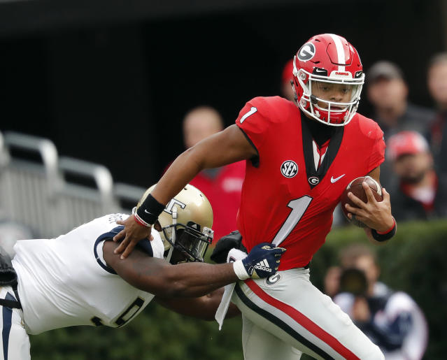 "Georgia QB <a class=""link rapid-noclick-resp"" href=""/ncaaf/players/287612/"" data-ylk=""slk:Justin Fields"">Justin Fields</a> is exploring a transfer. Where could he end up? Could he play immediately? (AP)"
