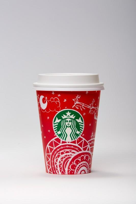 """<p>For her whimsical design, Eun Joo depicted Santa's sleigh on a starry night. Tiny snowmen adorn overlapping circles. """"There are many people - like different patterns of overlapping circles - but everyone can have happy memories with a cup of coffee at Starbucks."""" </p>"""