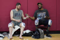 Kevin Love, left, and Kevin Durant laugh while passing a cell phone after practice for USA Basketball, Wednesday, July 7, 2021, in Las Vegas. (AP Photo/John Locher)