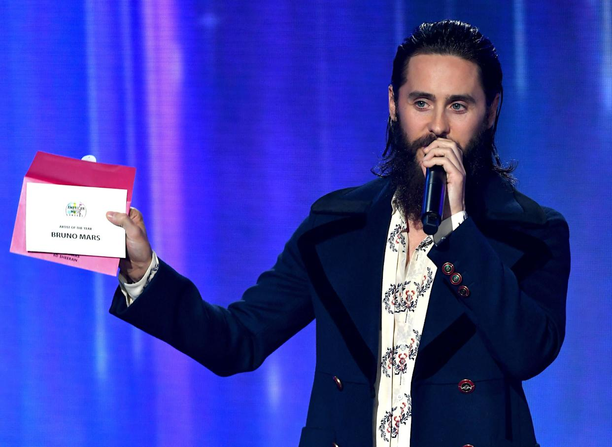 LOS ANGELES, CA - NOVEMBER 19: Jared Leto speaks while revealing a card announcing Bruno Mars as the winner of the Artist of the Year award onstage during the 2017 American Music Awards at Microsoft Theater on November 19, 2017 in Los Angeles, California. (Photo by Kevin Winter/Getty Images)