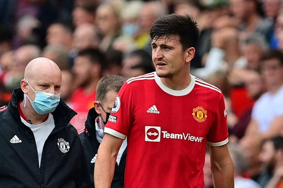 Harry Maguire sustained a calf injury during Manchester United's defeat by Aston Villa  (AFP via Getty Images)