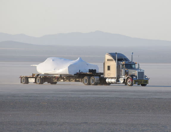 SNC's Dream Chaser test flight craft is hauled across the bed of Rogers Dry Lake at Edwards Air Force Base, Calif., to NASA's Dryden Flight Research Center on May 15, 2013.