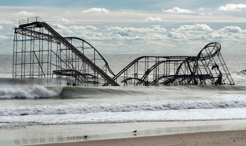 FILE PHOTO: The remnants of a roller coaster sits in the surf three days after Hurricane Sandy came ashore in Seaside Heights