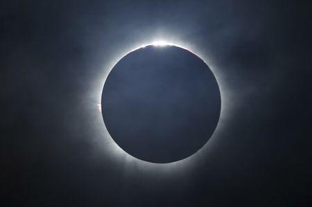 A solar eclipse is seen from the beach of Ternate island