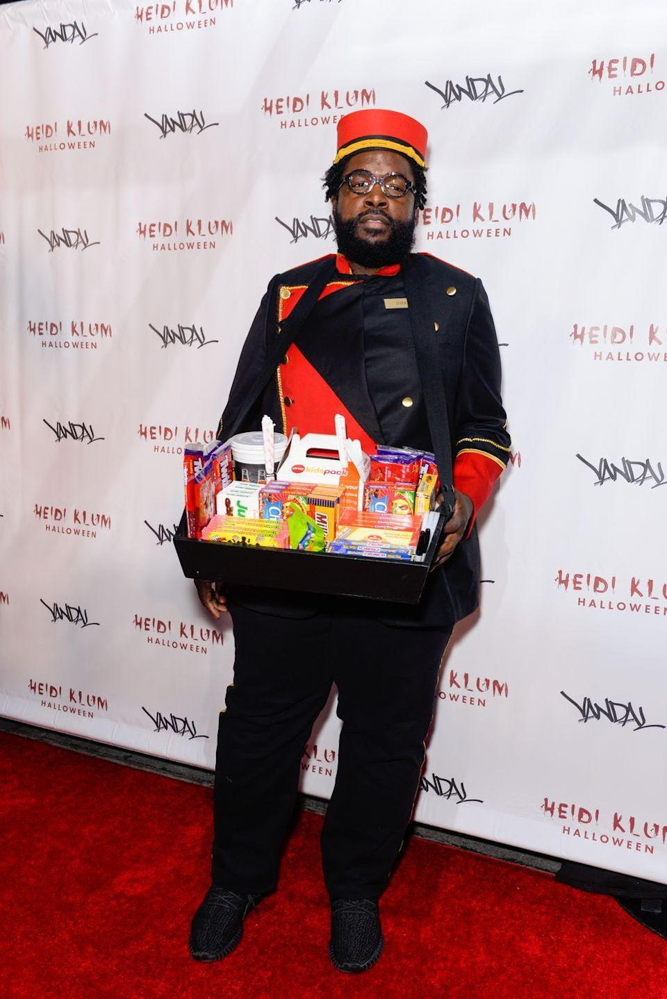 """<p>A black suit, a red bellhop hat, and a basket to wear around your neck is all your need for this clever candy vendor costume. The best part: You'll have snacks with you all night long in case you get hungry. </p><p><a class=""""link rapid-noclick-resp"""" href=""""https://www.amazon.com/Deluxe-Bellhop-Usher-Theatrical-Quality/dp/B00187Z38I/?tag=syn-yahoo-20&ascsubtag=%5Bartid%7C10070.g.28171554%5Bsrc%7Cyahoo-us"""" rel=""""nofollow noopener"""" target=""""_blank"""" data-ylk=""""slk:SHOP BELLHOP HAT"""">SHOP BELLHOP HAT</a></p>"""