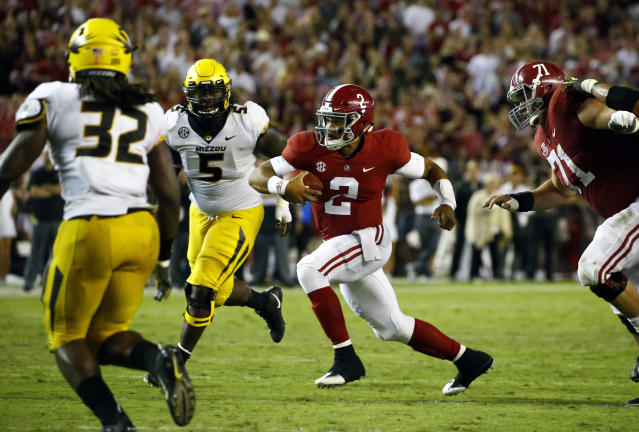 Alabama quarterback Jalen Hurts (2) scrambles for a first down during the second half of an NCAA college football game against Missouri, Saturday, Oct. 13, 2018, in Tuscaloosa, Ala. Alabama won 39-10. (AP Photo/Butch Dill)
