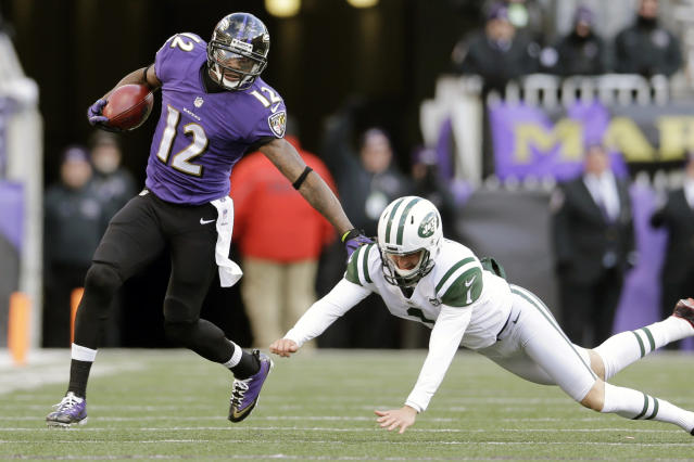 Baltimore Ravens wide receiver Jacoby Jones, left, out runs New York Jets punter Ryan Quigley on a punt return during the second half of an NFL football game in Baltimore, Sunday, Nov. 24, 2013. (AP Photo/Patrick Semansky)