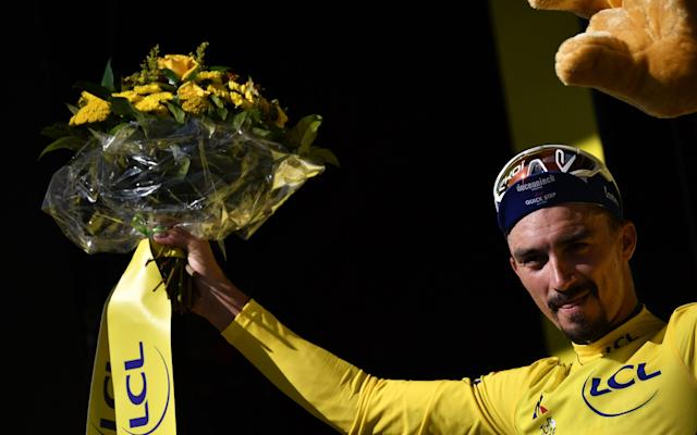 Julian Alaphilippe extended his lead on general classification following his second stage win at this year's Tour de France, Friday's individual time trial around Pau - AFP or licensors