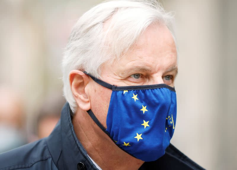 European Union's chief Brexit negotiator Michel Barnier returns to a hotel in London