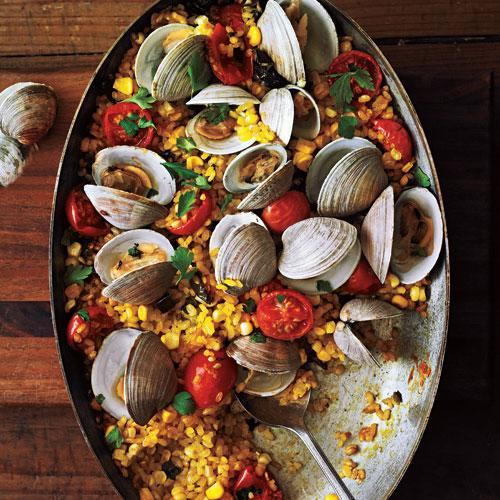 """<p>This recipe recieved rave reviews from <em>CL</em> staffers. """"Love the crunchy rice on the bottom of the pan, and clams lend the dish a delicious sweet brininess,"""" said Food Editor Tim Cebula.</p> <p> <a rel=""""nofollow noopener"""" href=""""http://www.myrecipes.com/recipe/paella-with-poblanos-corn"""" target=""""_blank"""" data-ylk=""""slk:View Recipe: Paella with Poblanos, Corn, and Clams"""" class=""""link rapid-noclick-resp"""">View Recipe: Paella with Poblanos, Corn, and Clams</a></p>"""