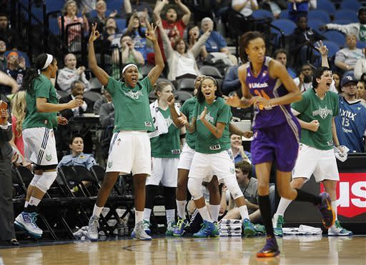 Minnesota Lynx cheer a 3-point basket during the second half of a WNBA basketball game against the Phoenix Mercury, Thursday, June 6, 2013, in Minneapolis. The Lynx won 99-79. (AP Photo/Stacy Bengs)