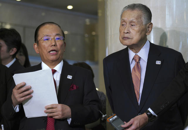 Tokyo Olympic organizing committee President Yoshiro Mori, right, and Toshiro Muto, left, CEO of the Tokyo Organizing Committee of the Olympic and Paralympic Games, speak to the media after attending an IOC Executive Board meeting Saturday, Dec. 1, 2018, in Tokyo. The IOC said boxing will take place at the 2020 Tokyo Olympics. But exactly who runs the tournament and the details of qualifying are up in the air because of charges of corruption and malfeasance surrounding the boxing federation that runs the sport at the Olympics. (AP Photo/Eugene Hoshiko)