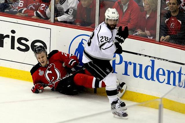 NEWARK, NJ - JUNE 09: Jarret Stoll #28 of the Los Angeles Kings collides with Anton Volchenkov #28 of the New Jersey Devils during Game Five of the 2012 NHL Stanley Cup Final at the Prudential Center on June 9, 2012 in Newark, New Jersey. (Photo by Jim McIsaac/Getty Images)